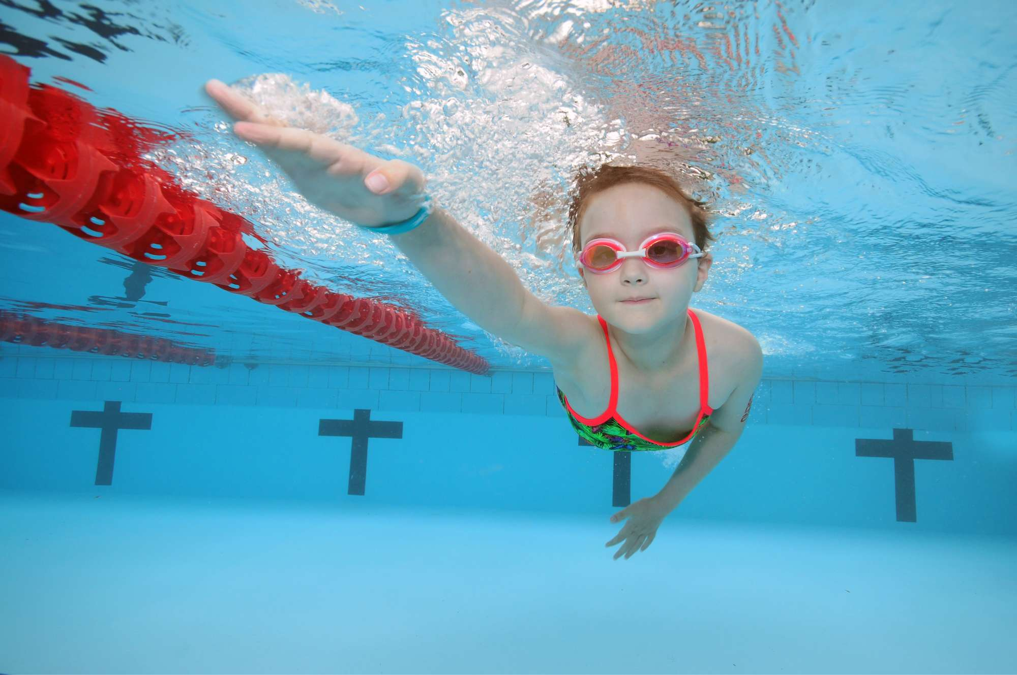 child in swimming class